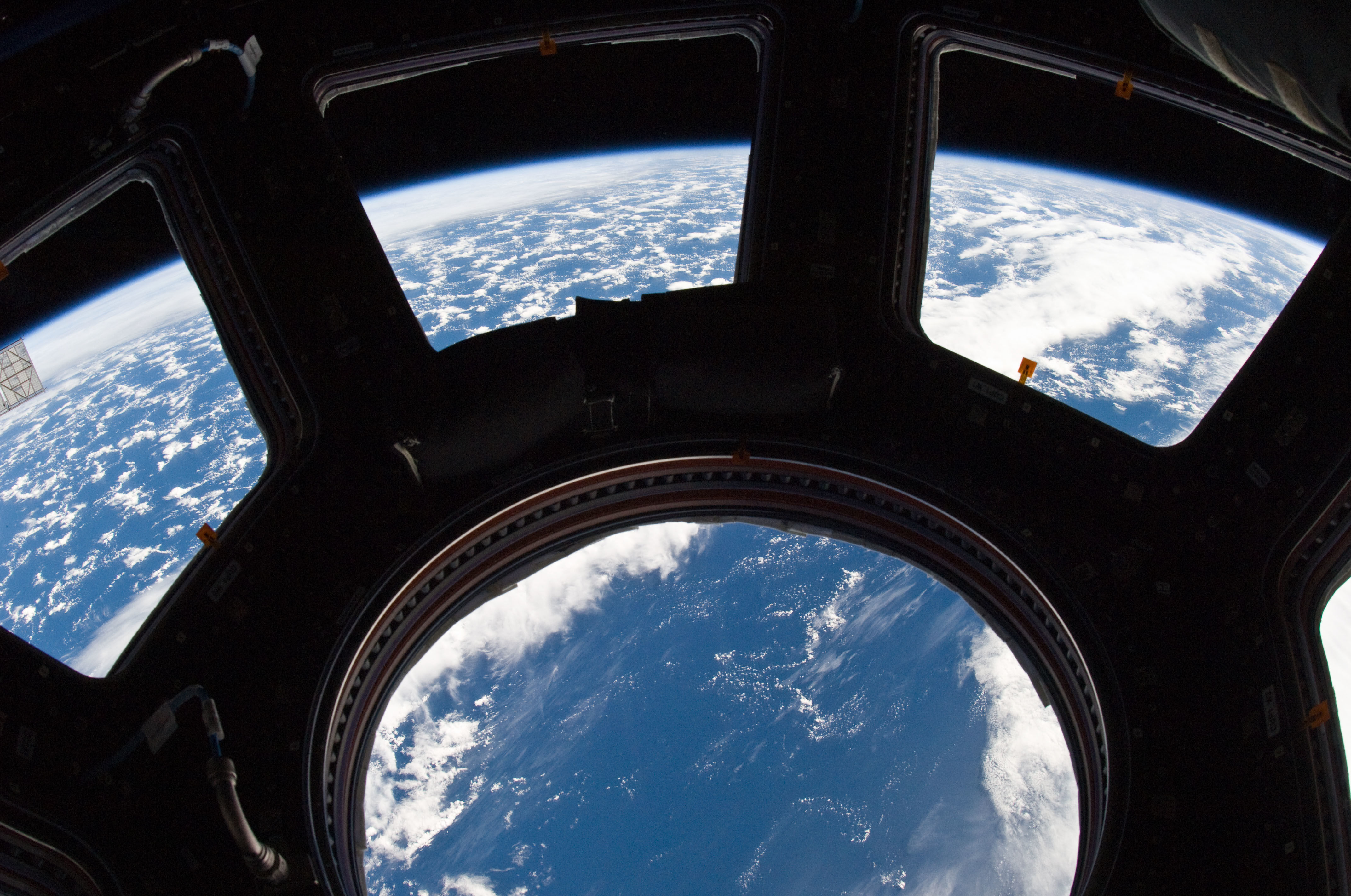 earth_and_its_horizon_seen_through_the_windows_in_cupola